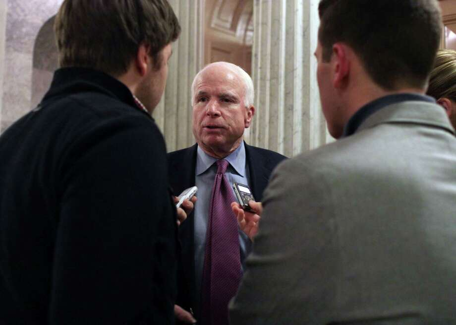 Sen. John McCain (R-AZ) talks with reporters after the Senate voted on a $1.1 trillion spending bill to fund the government through the next fiscal year on on Saturday, December 13, 2014 on Capitol Hill in Washington. (AP Photo/Lauren Victoria Burke) Photo: AP / FR132934 AP