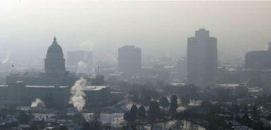 Smog hangs over downtown Salt Lake City in January. Photo: ASSOCIATED PRESS / AP2013