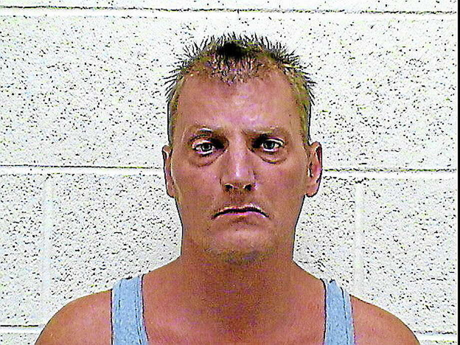Thomas H. Tanner, 43, of 98 Benham St., 2nd floor, Torrington, was arrested as a suspect in an armed robbery of the Smoker's Club on Main Street. Photo: Journal Register Co.