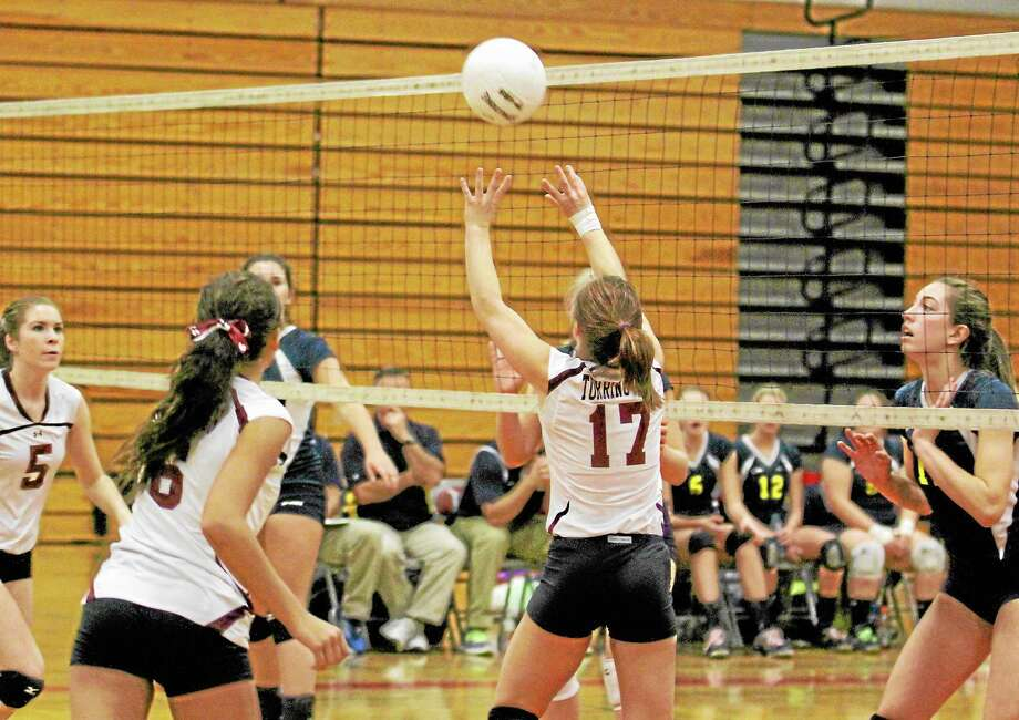 Torrington's Kiley Rosengrant sets up a teammate during the Red Raiders 3-0 loss to Woodstock Academy in the first round of the Class L State Tournament. Photo: Marianne Killackey — Special To The Register  / 2013