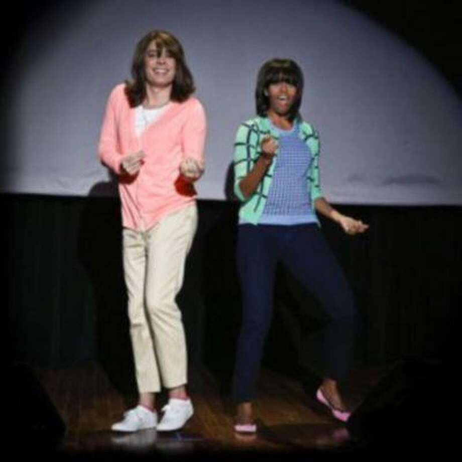 """Jimmy Fallon dressed as a mom, left, dances with first lady Michelle Obama during """"Late Night with Jimmy Fallon"""" on Feb. 22. Obama was on the show to promote her """"Let's Move"""" campaign and to perform in a skit called """"Evolution of Mom Dancing."""" (Lloyd Bishop/The Associated Press)"""