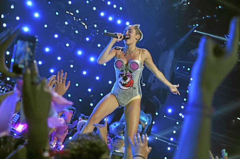 Miley Syrus performs at the MTV Video Music Awards. (AP Photo/MTV, John Shearer) Photo: AP / MTV