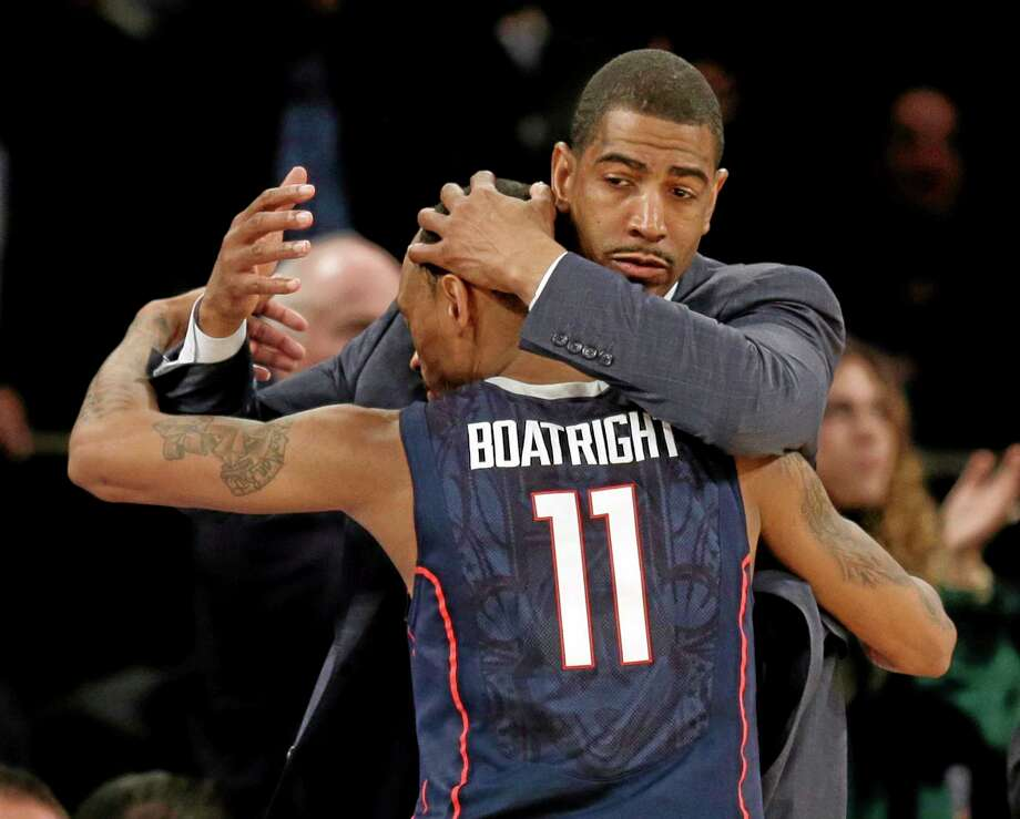 UConn coach Kevin Ollie hugs Ryan Boatright during the second half Friday's win over Iowa State. Photo: Seth Wenig — The Associated Press  / AP