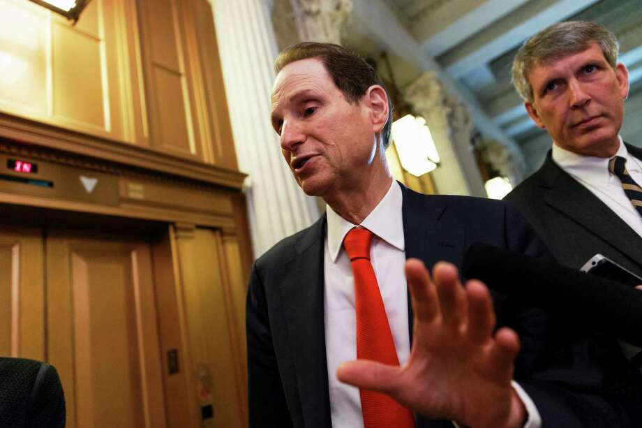Senate Finance Committee Chairman Sen. Ron Wyden, D-Ore. speaks with reporters about legislation to extend tax breaks in this file photo. After the November election, House and Senate leaders tried to make all 55 special-interest tax breaks in the bill permanent. Photo: File Photo  / AP