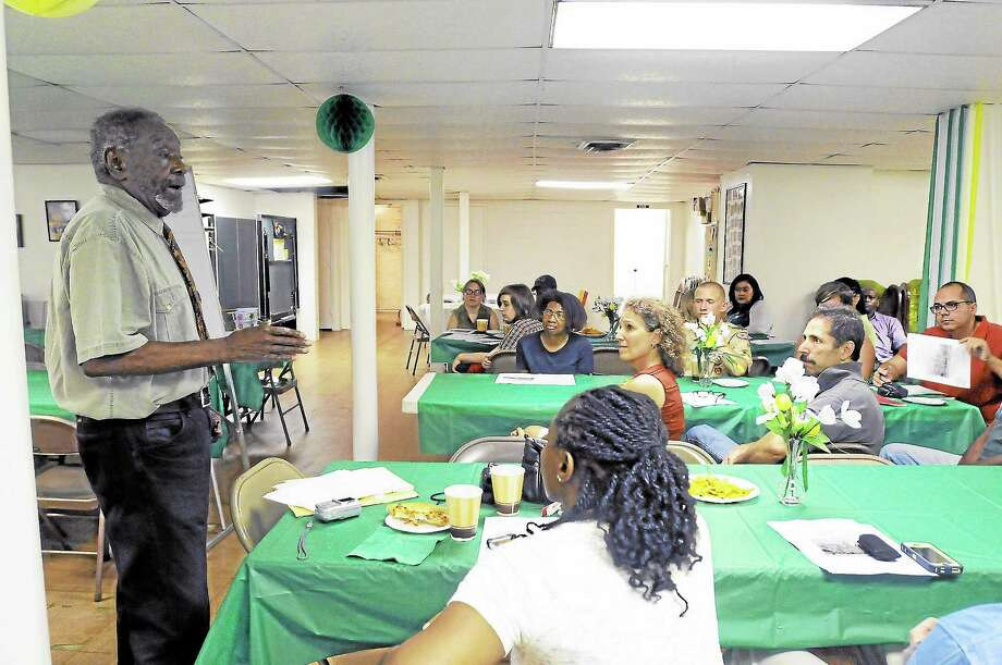 """William Battle speaks to a crowd of parents during an informal """"Family Night"""" at the Workman Memorial AME Zion Church in Torrington Friday night. Photo: Laurie Gaboardi—Register Citizen"""
