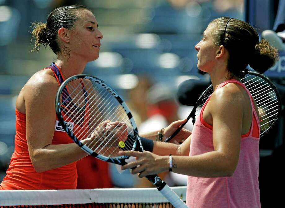 Flavia Pennetta greets Sara Errani at the net after beating Errani in their second-round match at the U.S. Open Thursday in New York. Photo: Kathy Willens — The Associated Press  / AP