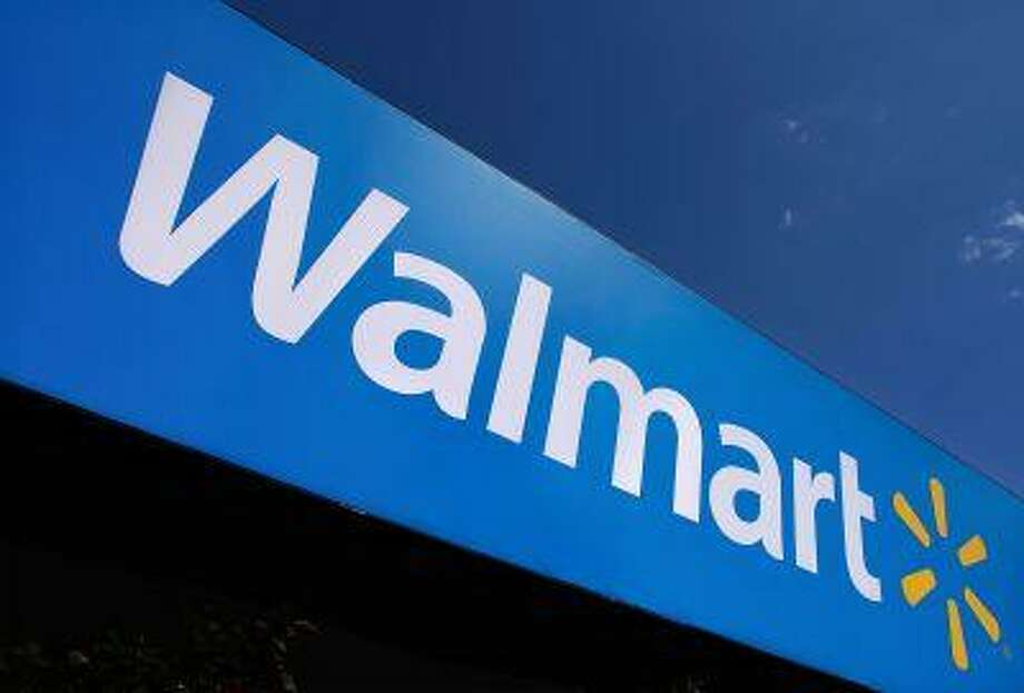 The Wal-Mart logo is displayed in Springfield, Ill. in this 2011 file photo. Photo: ASSOCIATED PRESS / AP2011