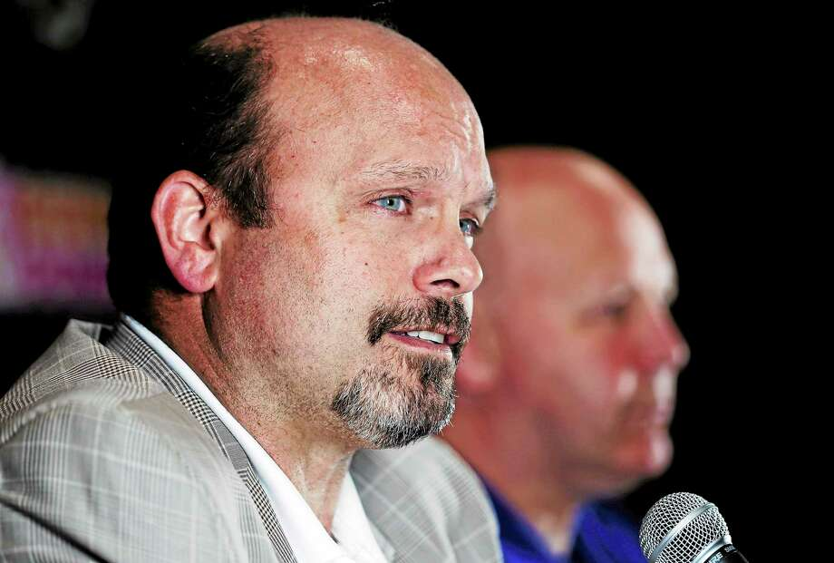 Boston Bruins general manager Peter Chiarelli, left, speaks during a news conference alongside coach Claude Julien on June 26 in Boston. Photo: Charles Krupa — The Associated Press  / AP