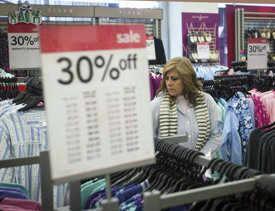 Giselle Basurto, of Mexico, shops at a Kmart store in New York on Thanksgiving Day. Photo: John Minchillo — The Associated Press  / FR170537 AP