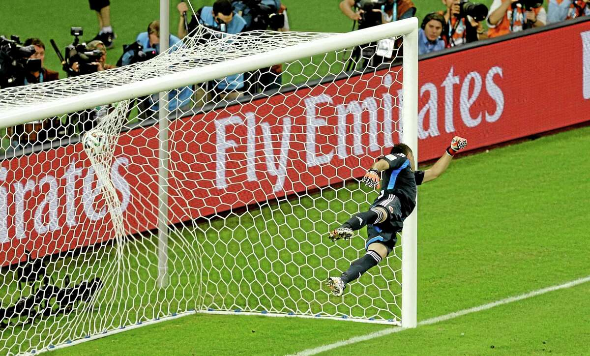 Colombia's goalkeeper David Ospina fails to make a save as Brazil's David Luiz scores his side's second goal during a World Cup quarterfinal match Friday at the Arena Castelao in Fortaleza, Brazil.