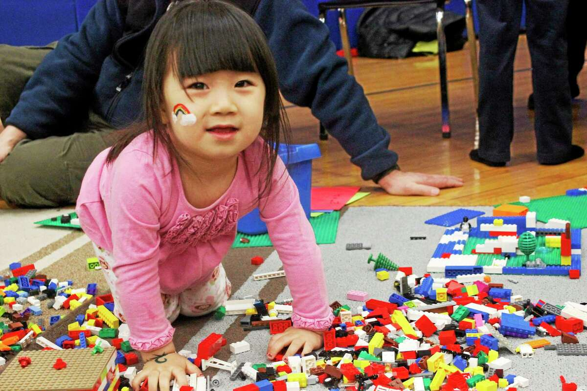 A child plays with Legos at the LEF Kids' Fest at Litchfield Intermediate School Saturday. See a gallery of photos from the event at Media.RegisterCitizen.com.