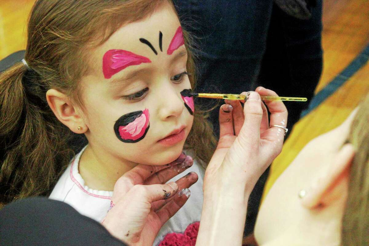 A child has her face painted at the LEF Kids' Fest at Litchfield Intermediate School Saturday.