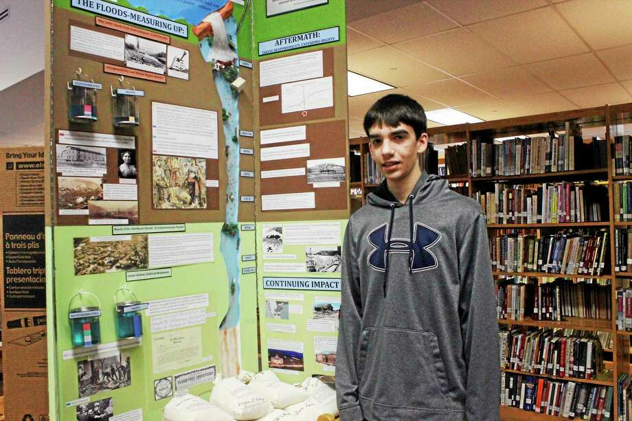 Fifteen-year-old Sam Procello and the flood project he presented during a History Day in Connecticut program at Torrington High School Saturday. Photo: Shako Liu — The Register Citizen