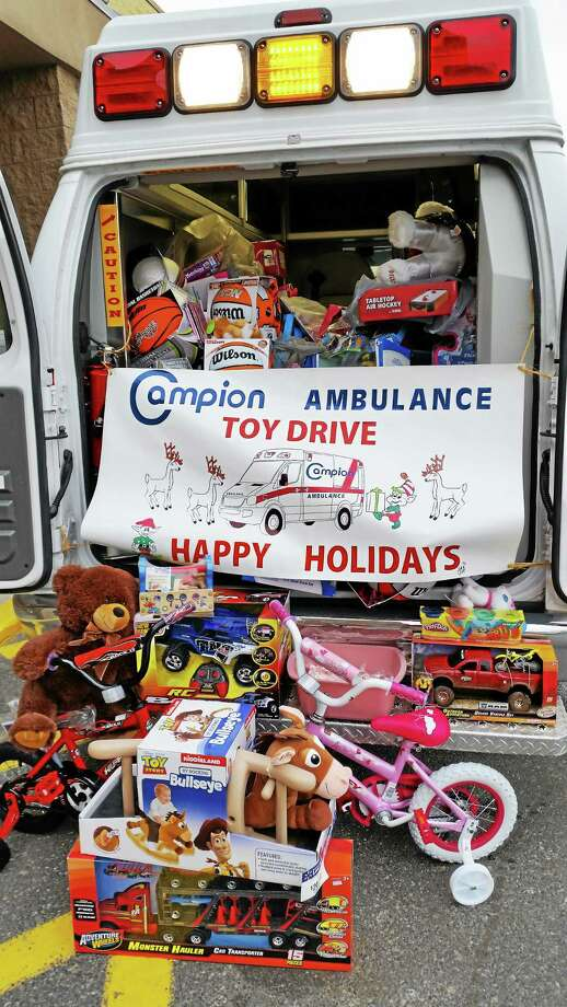 AMANDA WEBSTER — REGISTER CITIZEN Campion Ambulance stuffed an ambulance with donated toys and other gifts at WalMart on Friday in Torrington. Photo: Journal Register Co.