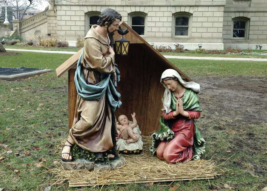 A nativity scene is displayed on the State House grounds in Lansing, Mich., Friday. Photo: David Eggert — The Associated Press  / AP