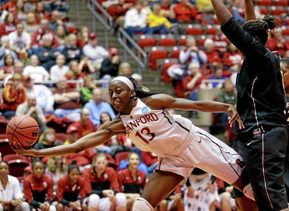 Stanford's Chiney Ogwumike (13) saves a ball from going out of bounds against Florida State's Kai James, right, in the second half of a second-round game in the NCAA women's college basketball tournament in Ames, Iowa, Monday, March 24, 2014. (AP Photo/Nati Harnik) Photo: AP / AP