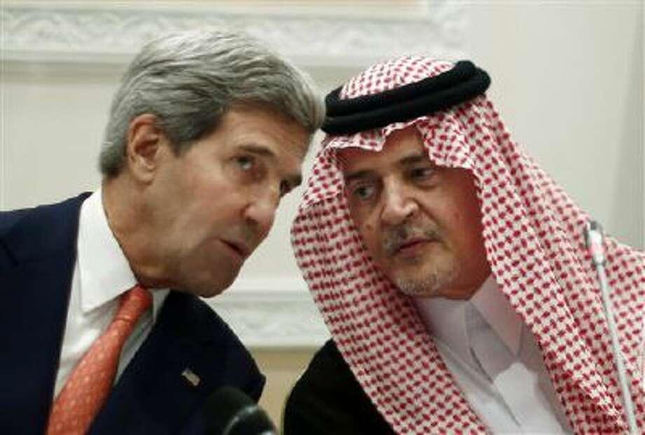 U.S. Secretary of State John Kerry, left, speaks Monday with Saudi Arabia's Foreign Minister Prince Saud al-Faisal in Riyadh. Photo: AP / Reuters Pool