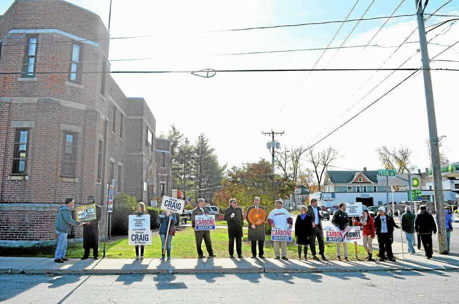 Candidates and campaign workers greet voters outside of the Torrington Armory Tuesday morning.John Berry - Register Citizen Photo: Journal Register Co.