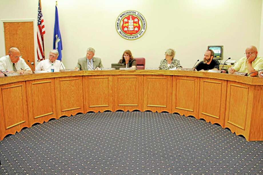 Members of the Winsted Town Government listen to Finance Director Robin Manuele (not pictured) during a Board of Selectmen meeting on Monday, June 3, 2013, in Winsted. All motions during the new business item of the agenda were passed unanimously by the five selectmen present. (ESTEBAN L. HERNANDEZ/REGISTER CITIZEN) Photo: Journal Register Co.