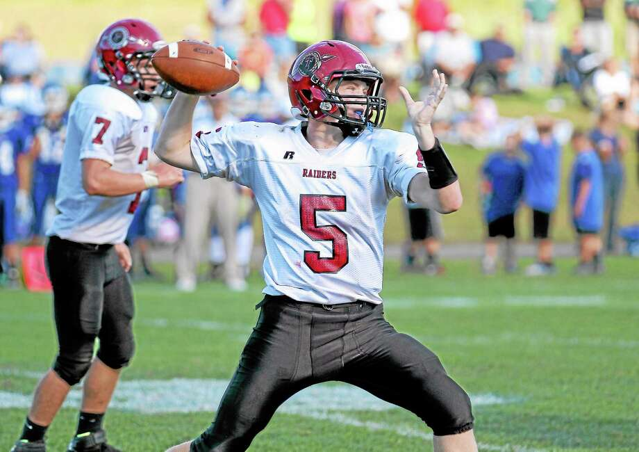In the last three games this season Connor Finn has thrown for five touchdowns and only one interception. Photo: Marianne Killackey — Register Citizen  / 2013