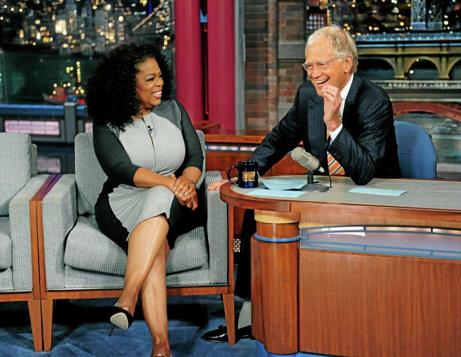 "In this photo provided by CBS Entertainment, talk show host, producer, publisher and actress Oprah Winfrey visits CBS's ""Late Show with David Letterman,"" Thursday, Aug. 1, 2013, in New York.  (AP Photo/CBS, John Paul Filo) Photo: AP / CBS ENTERTAINMENT"