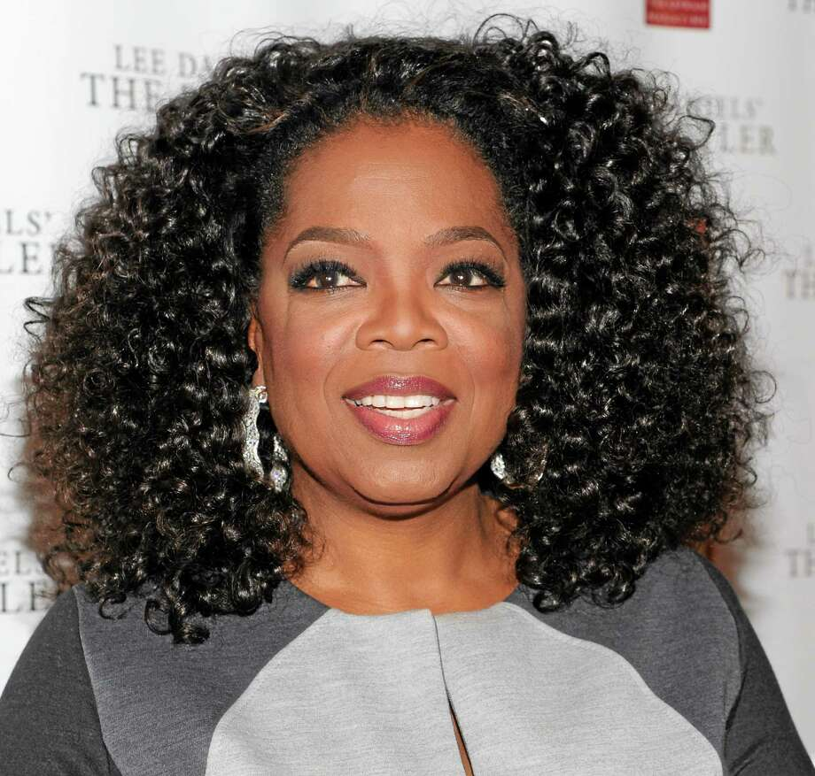 """FILE - In this July 31, 2013 file photo, media mogul and actress Oprah Winfrey attends a special screening of  """"Lee Daniels' The Butler"""" hosted by O, The Oprah Magazine, at Hearst Tower, in New York. Oprah's OWN channel is in the black for the first time since its rocky start two-and-a-half years ago. More than 30 new advertisers are joining original heavyweight sponsors Procter & Gamble and General Electric, and are paying higher rates as the channel has found its programming and distribution footing. (Photo by Evan Agostini/Invision/AP, File) Photo: Evan Agostini/Invision/AP / Invision"""
