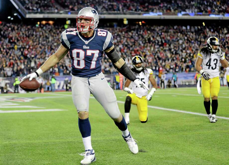 Patriots tight end Rob Gronkowski celebrates his touchdown catch in front of Steelers safeties Ryan Clark, back left, and Troy Polamalu (43) during the second quarter Sunday. Photo: Charles Krupa — The Associated Press  / AP