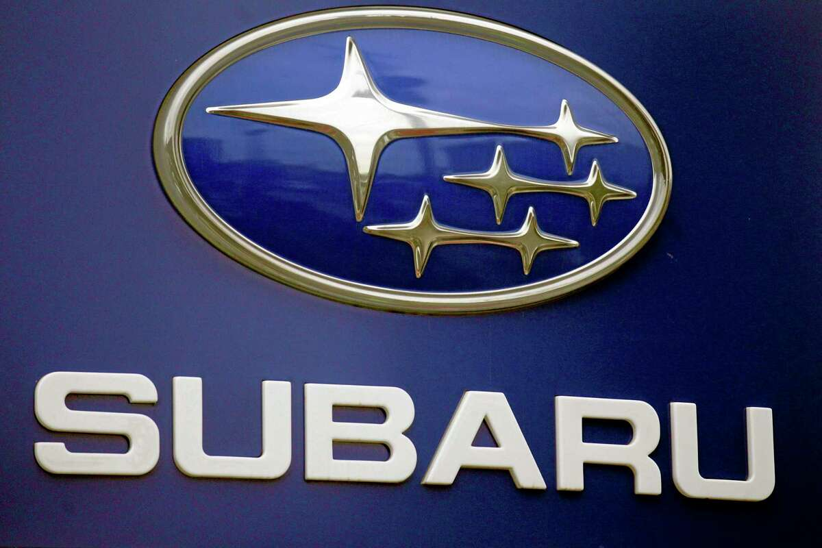 FILE - In this Aug. 31, 2011, file photo, a Subaru logo is displayed on a sign at a dealer's lot, in Portland, Ore. Subaru is recalling more than 660,000 cars and SUVs because the brake lines can rust and leak fluid, and that can cause longer stopping distances. For about half the vehicles, itís the second recall for the same problem. (AP Photo/Rick Bowmer, File)
