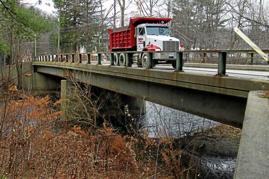 A heavy truck passes over the Bogue Road bridge on Thursday, Dec. 18, in Torrington. The city is seeking to repair the bridge with help from grant money, as it hasn't been repaired in more than three years. Esteban L. Hernandez Register Citizen Photo: Journal Register Co.