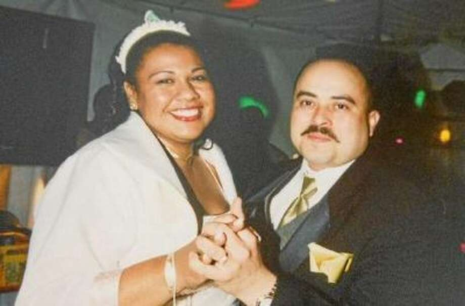 TSA Agent Gerardo Ismael Hernandez, 39, of Los Angeles died Friday, Nov. 1, 2013, after being wounded in a shooting rampage inside Terminal 3 at LAX, where he worked. He's pictured dancing with his sister-in-law Xiumara Hernandez of Azusa, Calif., at her wedding.