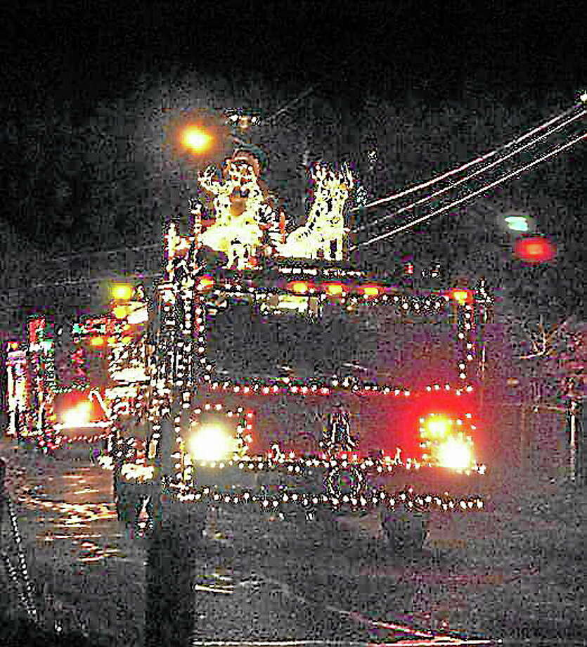 REGISTER CITIZEN FILE PHOTO ¬ A Winsted firetruck, decorated for the holidays, makes its way around the lake in the eight annual Gator Parade in 2011. Photo: Journal Register Co.