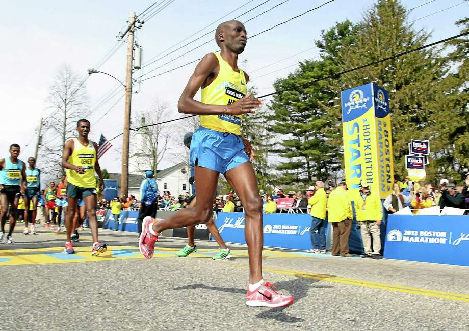 FILE - In this April 15, 2013, file photo, Wesley Korir, of Kenya, warms up prior to the start of the 117th running of the Boston Marathon, in Hopkinton, Mass. Korir had recently been elected to Parliament in his native Kenya. (AP Photo/Stew Milne, File) Photo: AP / FR56276 AP