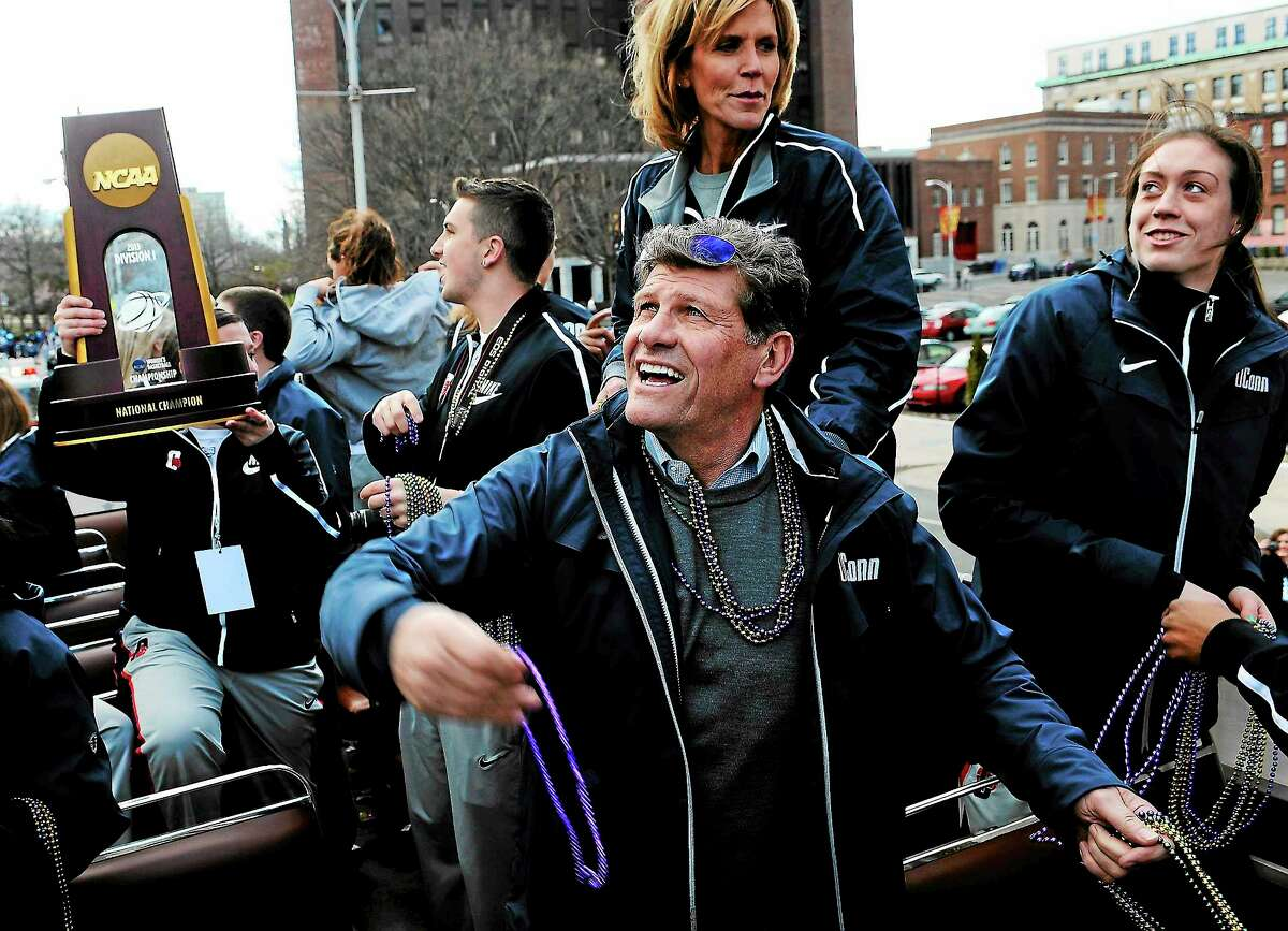 UConn coach Geno Auriemma throws Mardi Gras beads during a parade celebrating the UConn women's basketball team's national championship victory on April 14 in Hartford.