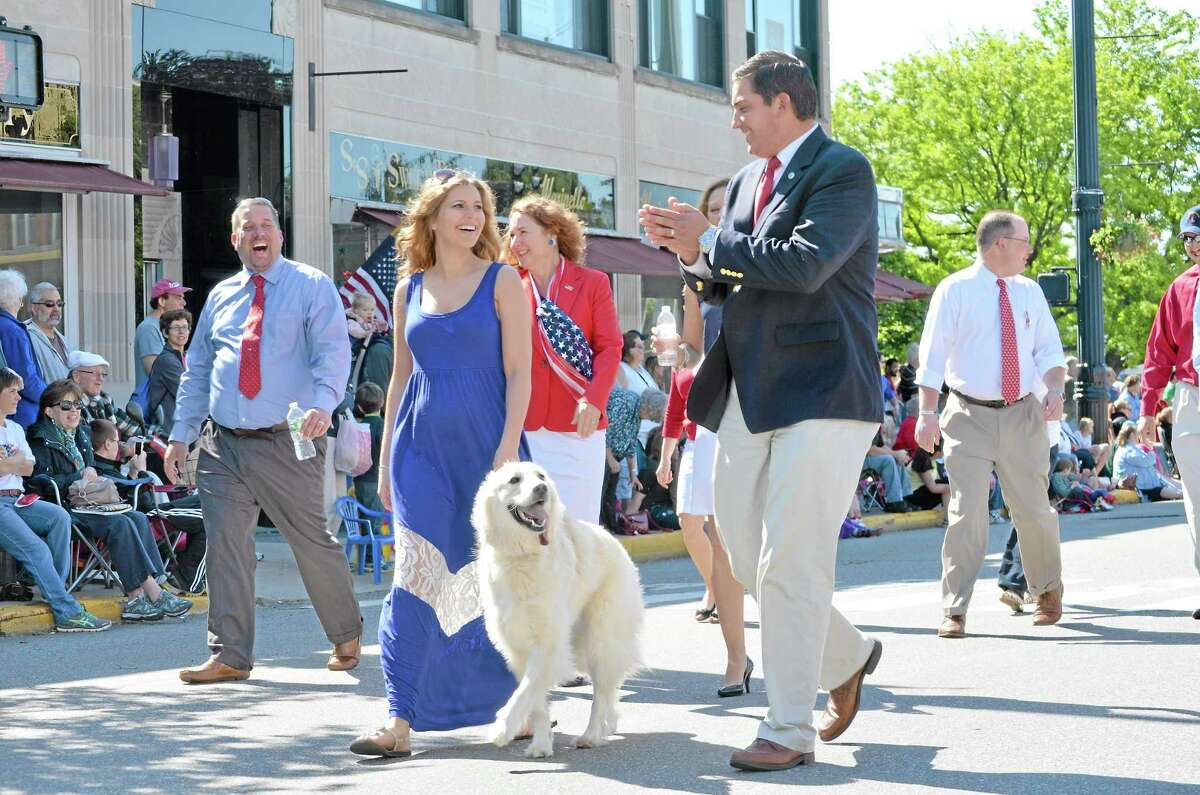 Mayor Ryan Bingham marches with his wife, Jennifer, in Torrington's Memorial Day Parade on Monday, May 27, 2013.