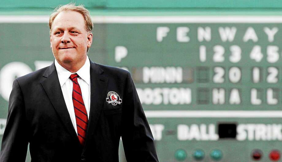 Former Boston pitcher Curt Schilling looks on after being introduced as a new member of the Red Sox Hall of Fame at Fenway Park on Aug. 3, 2012. Photo: Winslow Townson — The Associated Press  / AP2012