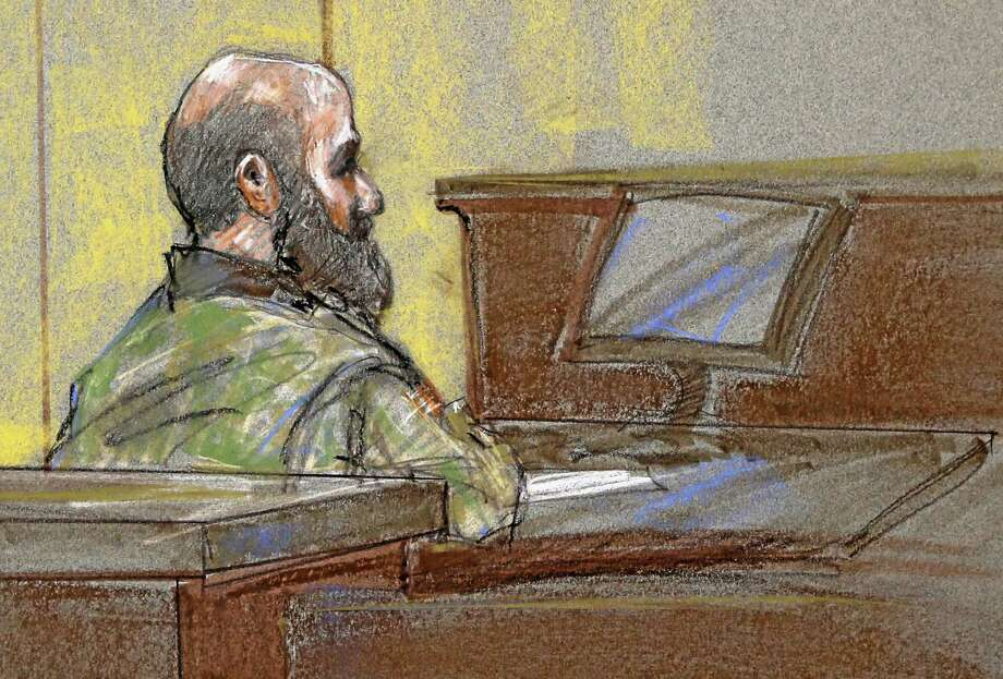 File - In this Aug. 23, 2013 file courtroom sketch, U.S. Army Maj. Nidal Malik Hasan is shown as the guilty verdict is read at his court martial, in Fort Hood, Texas. A military jury has sentenced Hasan to death for the 2009 shooting rampage at Fort Hood that killed 13 people and wounded more than 30 others. (AP Photo/Brigitte Woosley, File) Photo: AP / FR170958 AP