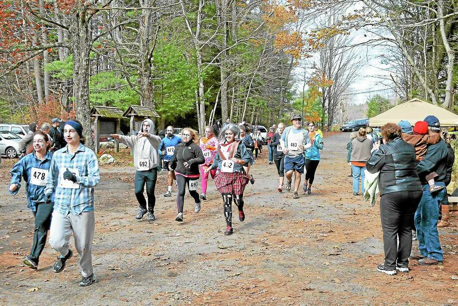 Runners dressed as zombies head out onto the race course at Sunny Brook State Park as part of a 5K Sunday that benefitted the Northwest CT YMCA. See more photos at media.registercitizen.com. Photo: Photos By Kate Hartman — Register Citizen