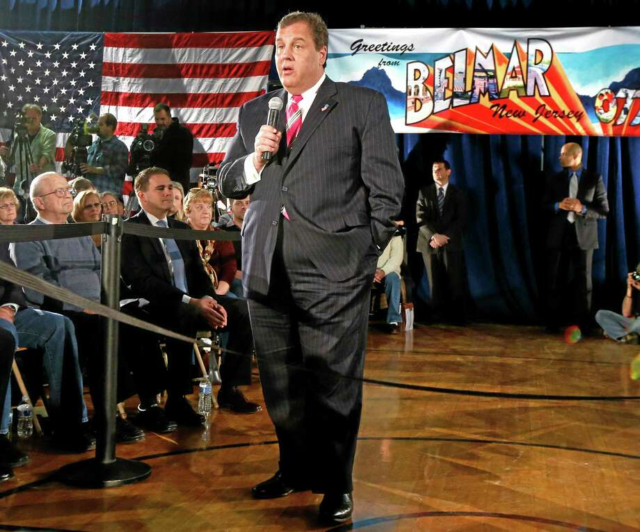 """FILE -  In a March 25, 2014 , file photo New Jersey Gov. Chris Christie talks during a town hall meeting  in Belmar, N.J.     Christie says undergoing gastric bypass surgery more than a year ago was a """"life-changing decision."""" (AP Photo/Julio Cortez, file) Photo: AP / AP"""