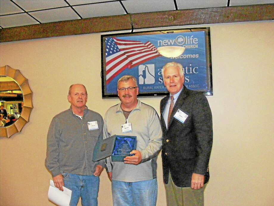Left to right, Jim McCarthy, Chief Distribution System Operator, Jeffrey Rines, Chief Water Treatment Plant Operator and Ed Bailey ASRWWA Board Member at the award ceremony. Photo: Contributed Photo