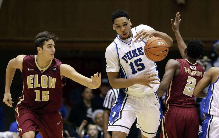 Duke's Jahlil Okafor grabs the ball as Elon's Tony Sabato, left, and Dmitri Thompson defend during the second half of the Blue Devils' 75-62 win on Monday in Durham, N.C. Photo: Gerry Broome — The Associated Press  / AP