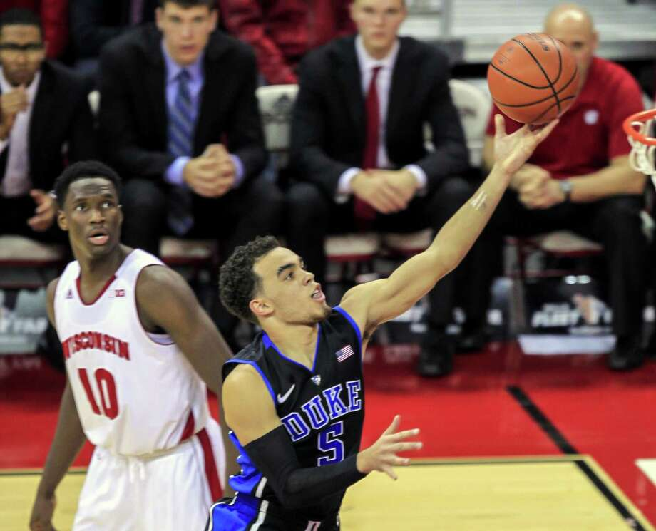 Duke's Tyus Jones shoots past Wisconsin's Nigel Hayes during the first half of the Blue Devils' 80-70 win on Dec. 3 in Madison, Wis. Photo: Andy Manis — The Associated Press File Photo  / FR19153 AP