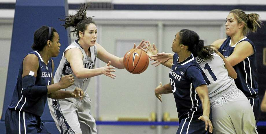 Natalie Butler, second from left, is sitting out this season for UConn after transferring in from Georgetown. Photo: Luis M. Alvarez — The Associated Press File Photo  / FR596 AP