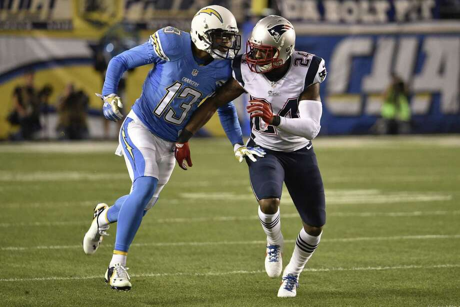 Chargers receiver Keenan Allen, left, and New England Patriots cornerback Darrelle Revis bump during a Dec. 7 game in San Diego. Photo: Denis Poroy — The Associated Press  / FR59680 AP