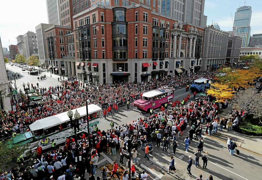 Duck Boats carrying Boston Red Sox players make their way down Boylston Street during a victory parade celebrating the team's third World Series title since 2004, Saturday, Nov. 2, 2013, in Boston. (AP Photo/Michael Dwyer) Photo: AP / AP