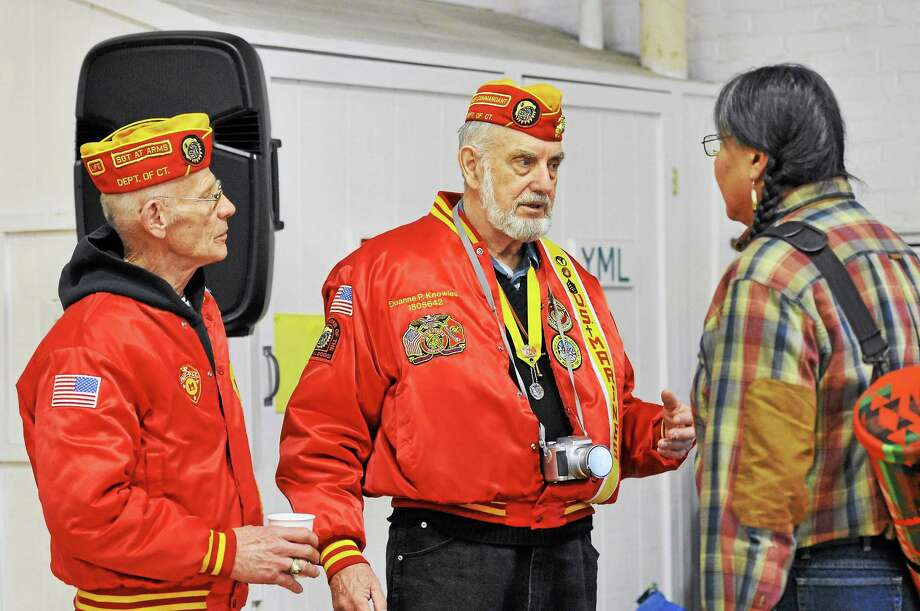 John Clark, commandant of Memorial Detachment #1142, and former Marine Gunnery Sgt. Duanne Knowles talk to Joseph Firecrow during a FISH's Veteran Stand Down event at the Torrington Armory Wednesday. Photo: Laurie Gaboardi — Register Citizen