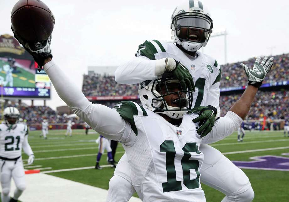 New York Jets receiver Percy Harvin (16) celebrates with teammate Jeremy Kerley after catching a 35-yard touchdown pass during a Dec. 7 game against the Minnesota Vikings in Minneapolis. Photo: Alex Brandon — The Associated Press  / AP