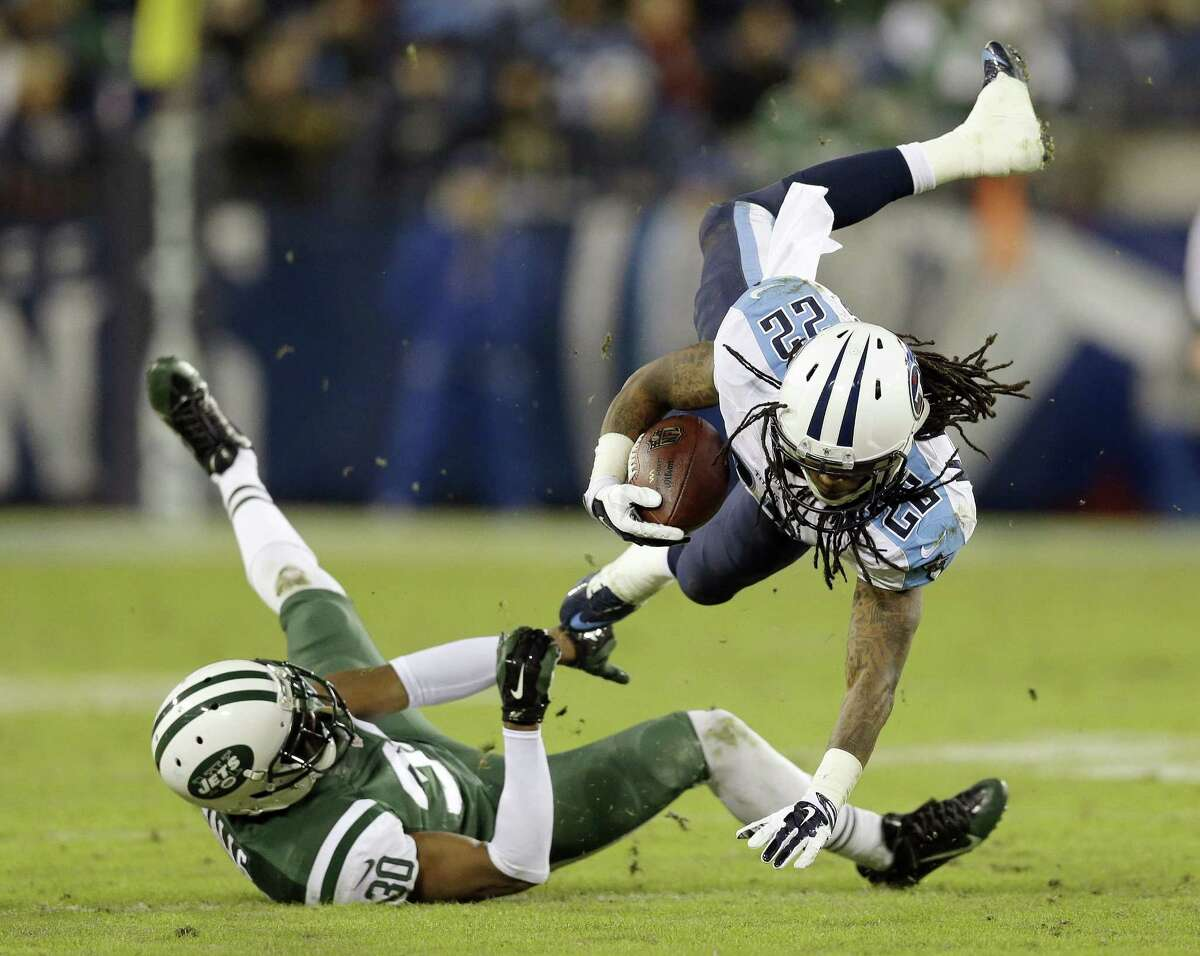 Tennessee Titans running back Dexter McCluster is brought down by New York Jets cornerback Darrin Walls during Sunday's game in Nashville, Tenn.