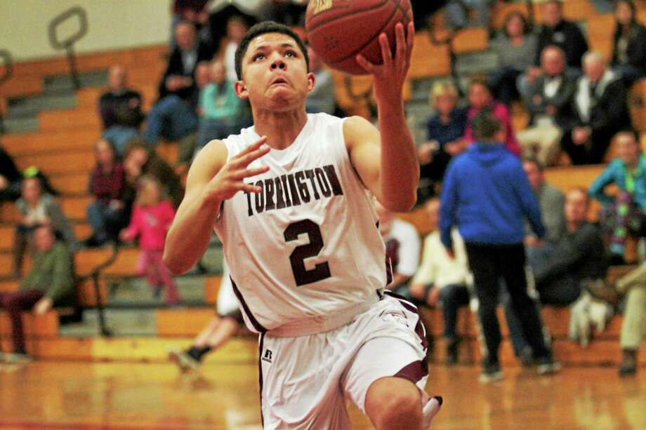 Torrington's Stephon Dailey  goes up for a shot against Derby Wednesday night. Photo: Marianne Killackey — Special To Register Citizen  / 2014
