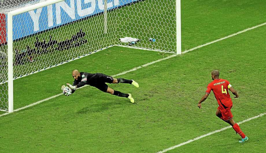 United States goalkeeper Tim Howard makes a save on Belgium's Vincent Kompany during Tuesday's World Cup match at the Arena Fonte Nova in Salvador, Brazil. Photo: Themba Hadebe — The Associated Press  / AP