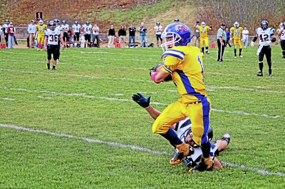 Gilbert/Northwestern wide receiver Seth Dayton catches a 52-yard touchdown pass as Avon's Geoffrey Kirk defends. The Yellowjackets won 34-33. Photo: Sean Meenaghan — Register Citizen
